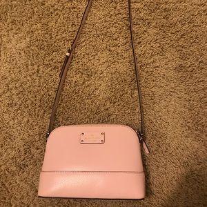 Light pink kate spade side purse.
